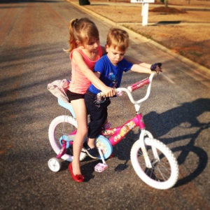 S and W ride a bike