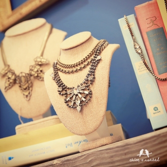 c+i necklaces and books