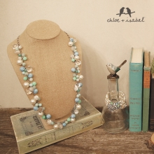 c+o sea pearls with books